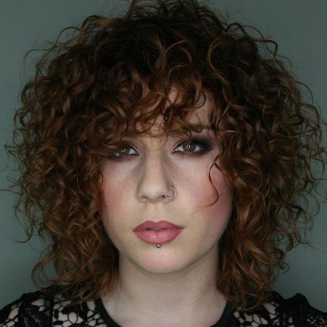 med length curly brunette hair